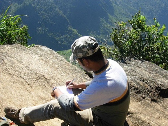 Updating my journal at World's End, Horton Plains, Sri Lanka