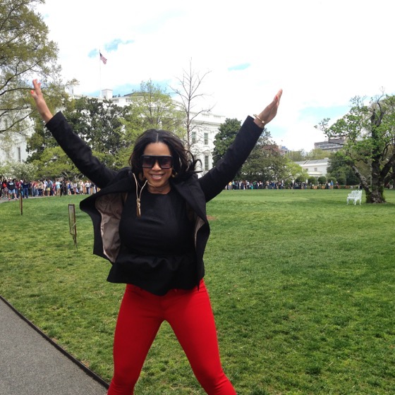 Ashlee Tuck of Will Drink For Travel in front of The White House
