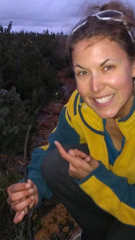 Jema Patterson of Half The Clothes finding a rare flower – a black kangaroo paw – on a sunset run in an Australian National Park