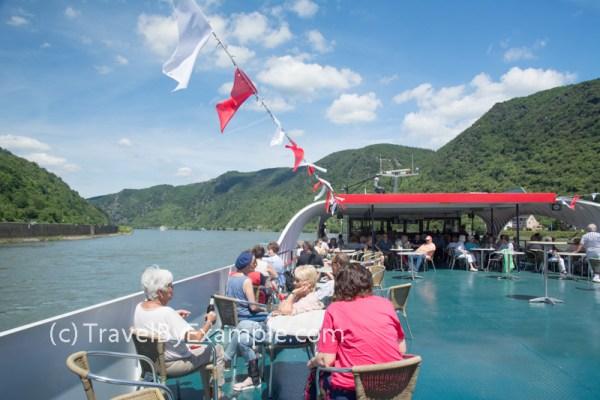 Passengers enjoying KD Cruise on the upper deck