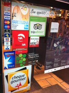 Stickers Covering a Restaurant Window in Barcelona