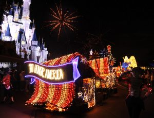 """TO HONOR AMERICA: Disney's Main Street Electrical Parade marches through the Magic Kingdom this summer, twinkling with approximately half a million lights. The patriotic finale float was created """"To Honor America"""" with its giant American flag and the national symbol of the American Bald Eagle. The beloved parade returns to Magic Kingdom to headline """"Summer Nightastic!"""" June 6 through Aug. 14, 2010. Guests can Learn more about """"Summer Nightastic!"""" and check out deals for summer travel by visiting www.disneyworld.com/night or by calling 407/W-DISNEY (934-7639) or a local travel agent. (Gene Duncan, photographer)"""