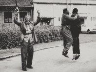 MAY 1963 - Kanu Sweeps To Power. Jumping for joy, Jomo Kenyatta, with Tom Mboya and Mwai Kibaki, celebrate KANU's victory in the independence election.