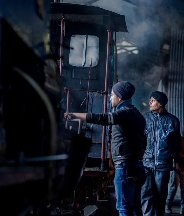 Workmen building up the steam in the Locos