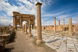 Algeria. Timgad (ancient Thamugadi or Thamugas). Decumanus Maximus street and surrounding colonnade terminated Trajan's Arch.