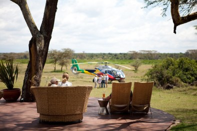 Helicopter lands at Solio Lodge, Kenya, Africa