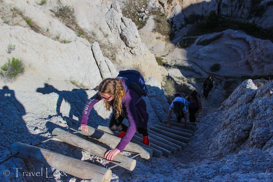 Climbing up the wooden ladder - Notch Trail