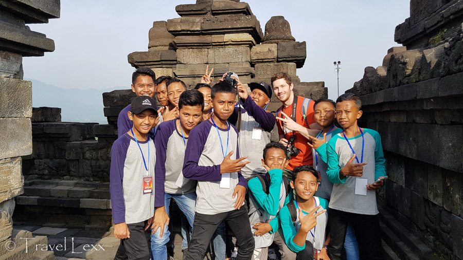 A group of people taking a photo at Borobudur