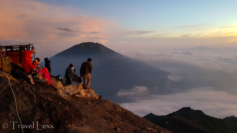 A group of people at the summit of Mt. Merapi volcano