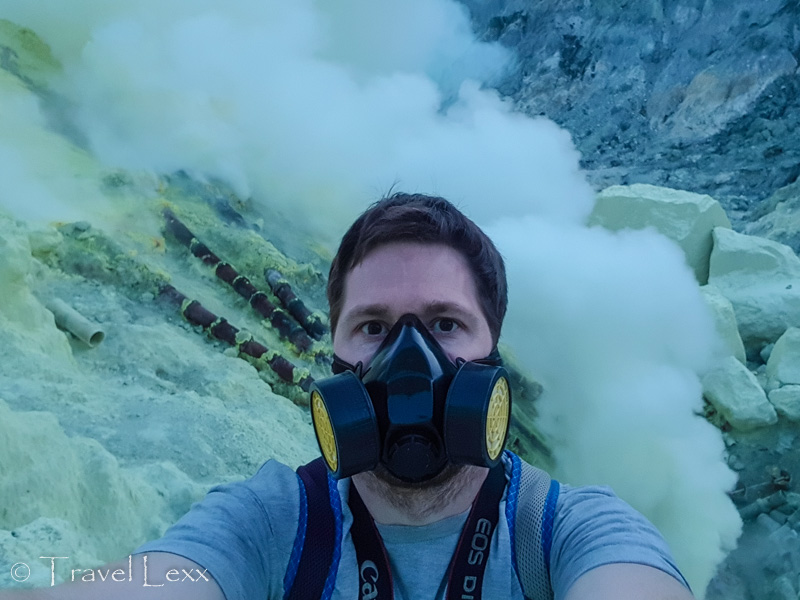 Wearing a gas mask in Kawah Ijen crater