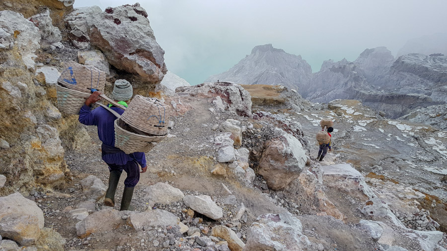 Miners heading down into Kawah Ijen crater with baskets