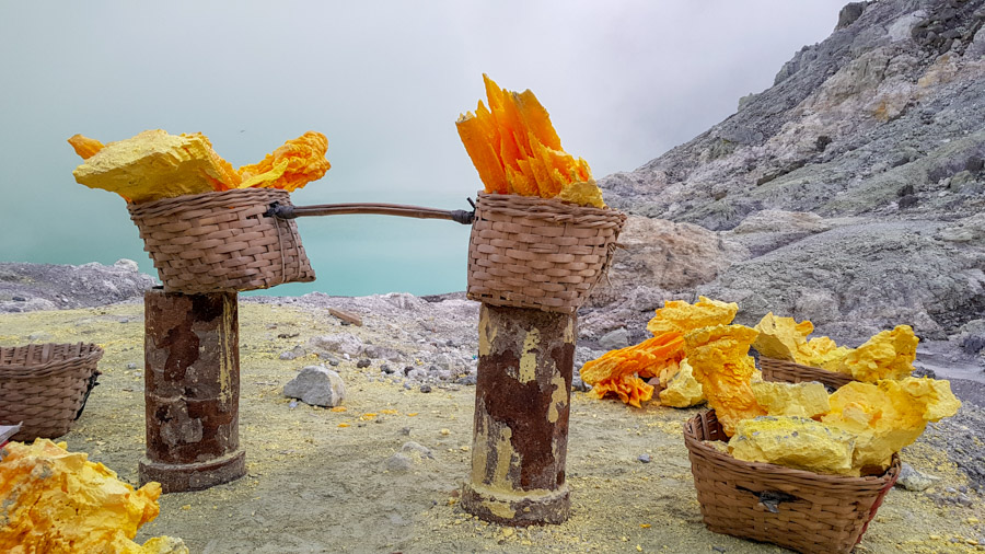 Sulphur in woven baskets at the bottom of Kawah Ijen crater