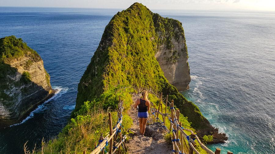 A woman walking down a rocky path