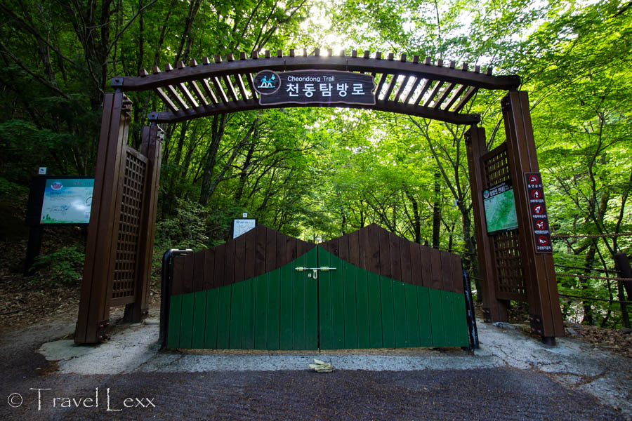 A large wooden gate marking the start of the Cheondong Trail