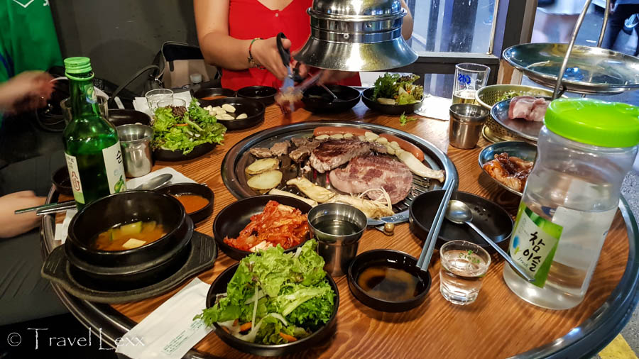 Grilled meat and vegetables on a table in a restaurant in Seoul