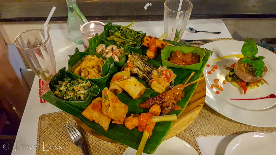 A selection of Indonesian food in a banana leaf