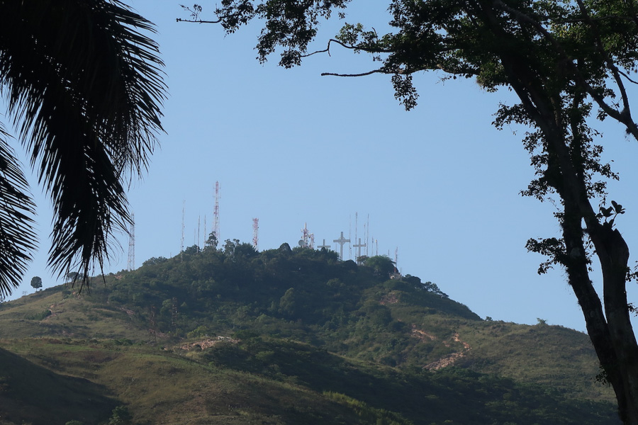 A view of crosses atop a hill on the El Cerro de las Tres Cruces day hike near the city of Cali in Colombia