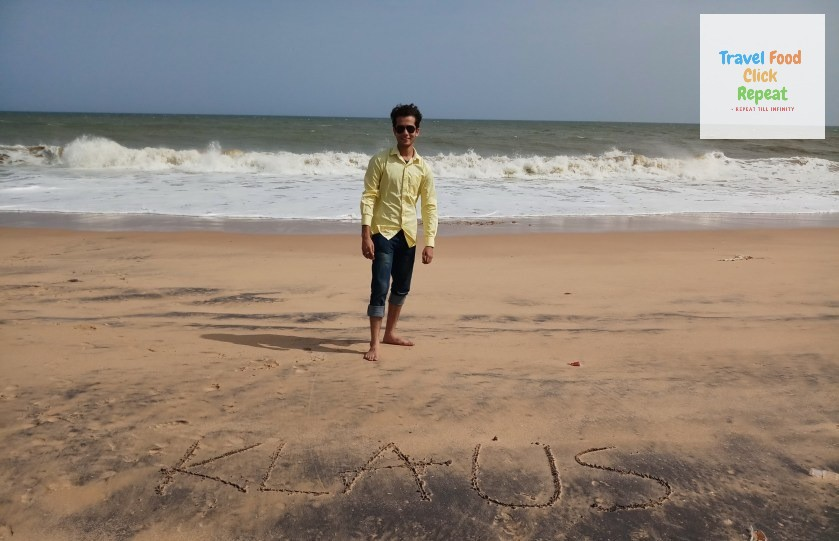 Shubham-Jain-standing-on-a-Beach-with-Klaus-written-on-sand