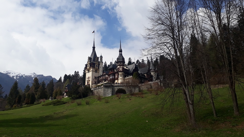 Peles Castle and the mountains in the distance