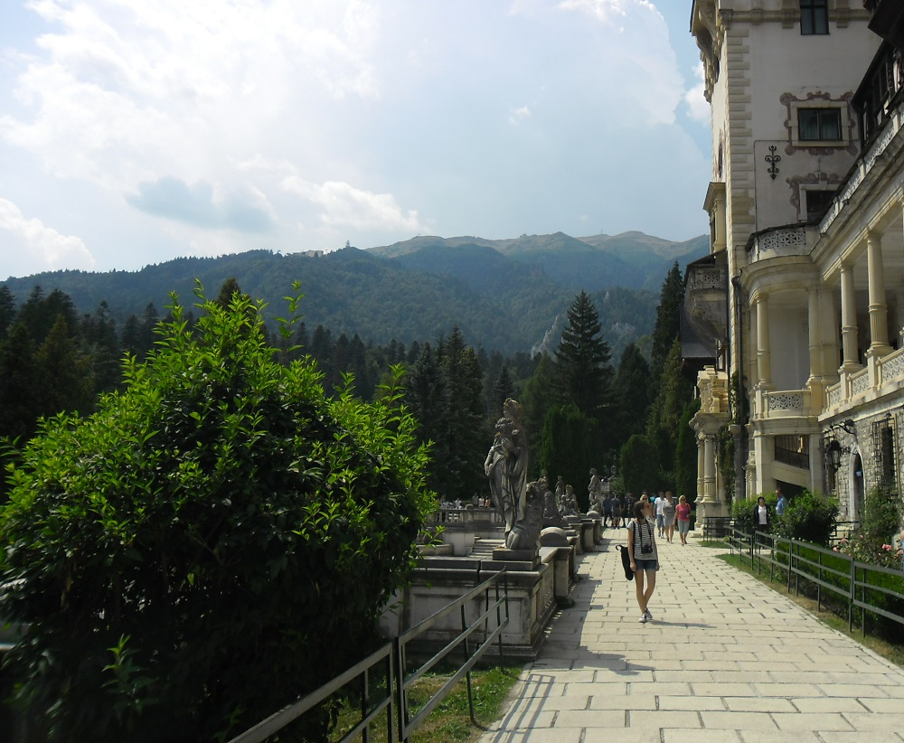 The terrace in front of Peles Castle with the mountains in the back