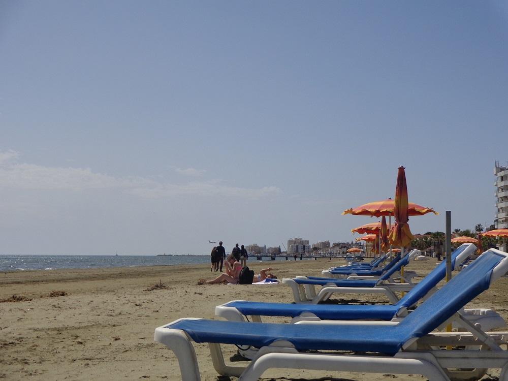Sunbeds and umbrellas on Finikoudes Beach in Larnaca.
