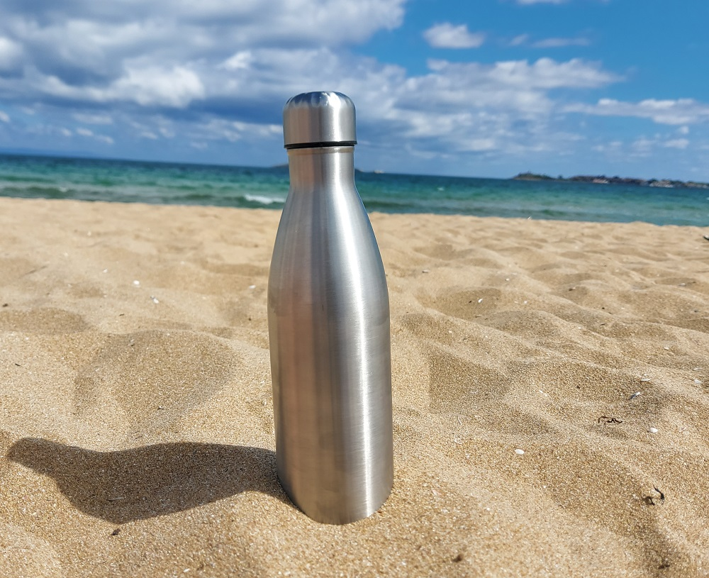 Bringing a reusable water bottle at the beach is always a good idea.