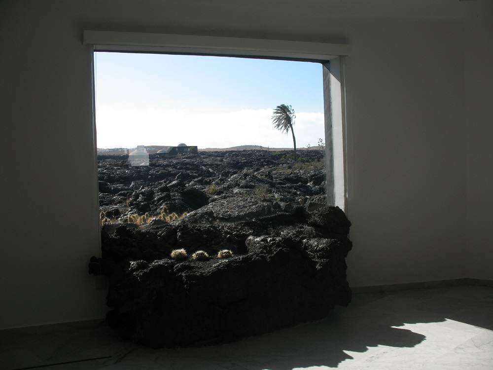 A lava stone brought inside the living area, a unique view and design.