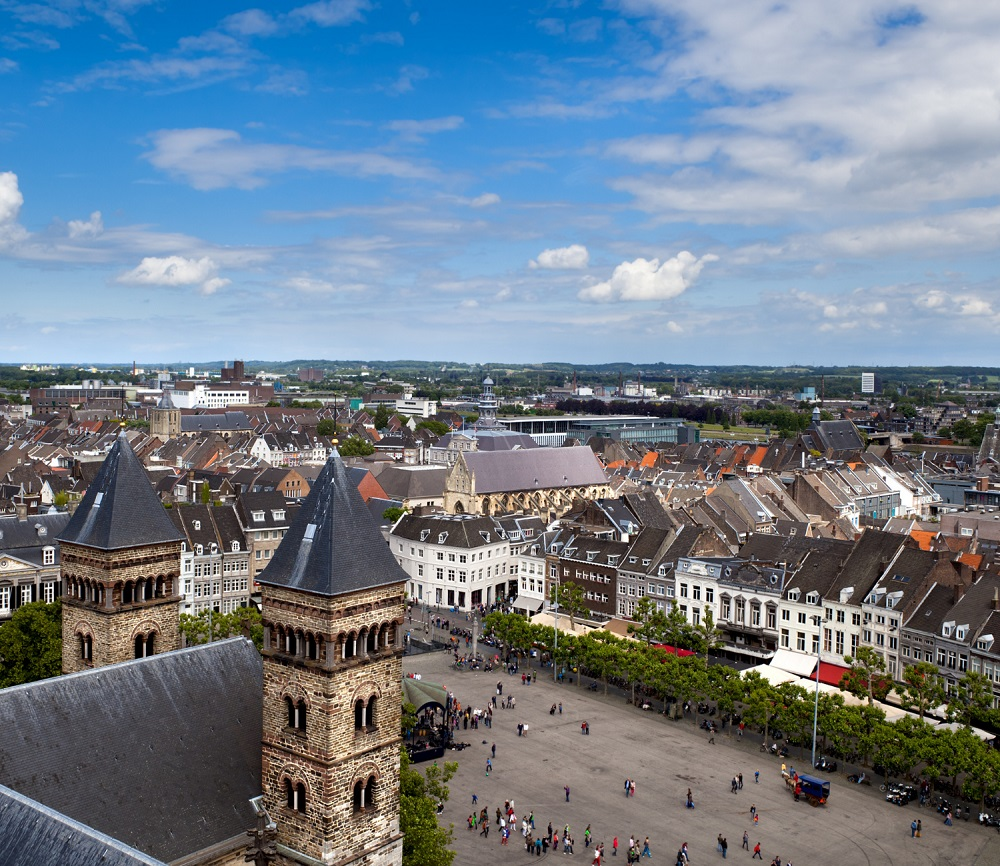 An ample square in Maastricht surrounded by traditional Dutch houses.