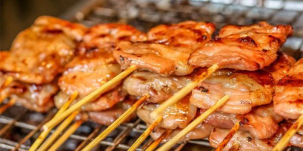 grilled meat threaded on a bamboo stick