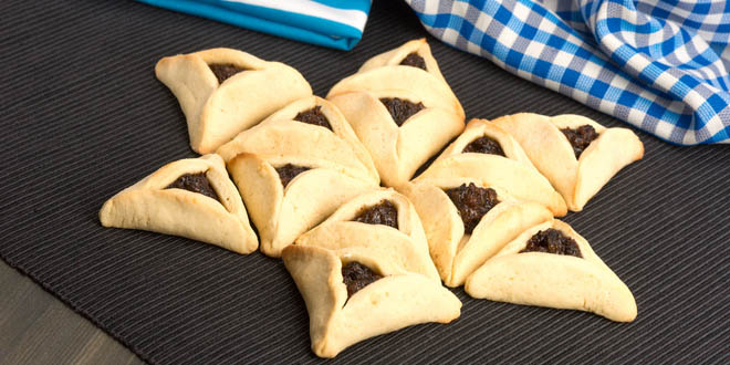 Triangular jewish pastries called Hamantaschen, some of the most popular Purim foods and drinks