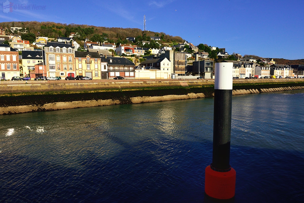Row of fishermen houses at the Fecamp harbour entrance