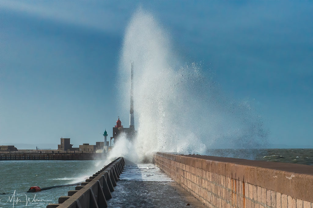 Two lighthouses of the Le Havre harbour entrance in a storm