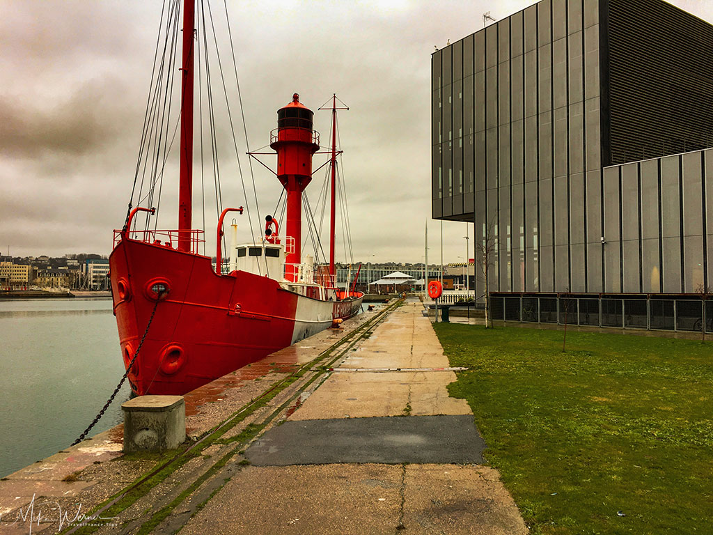 Lighthouse ship in the Le Havre harbour next to one of the universities