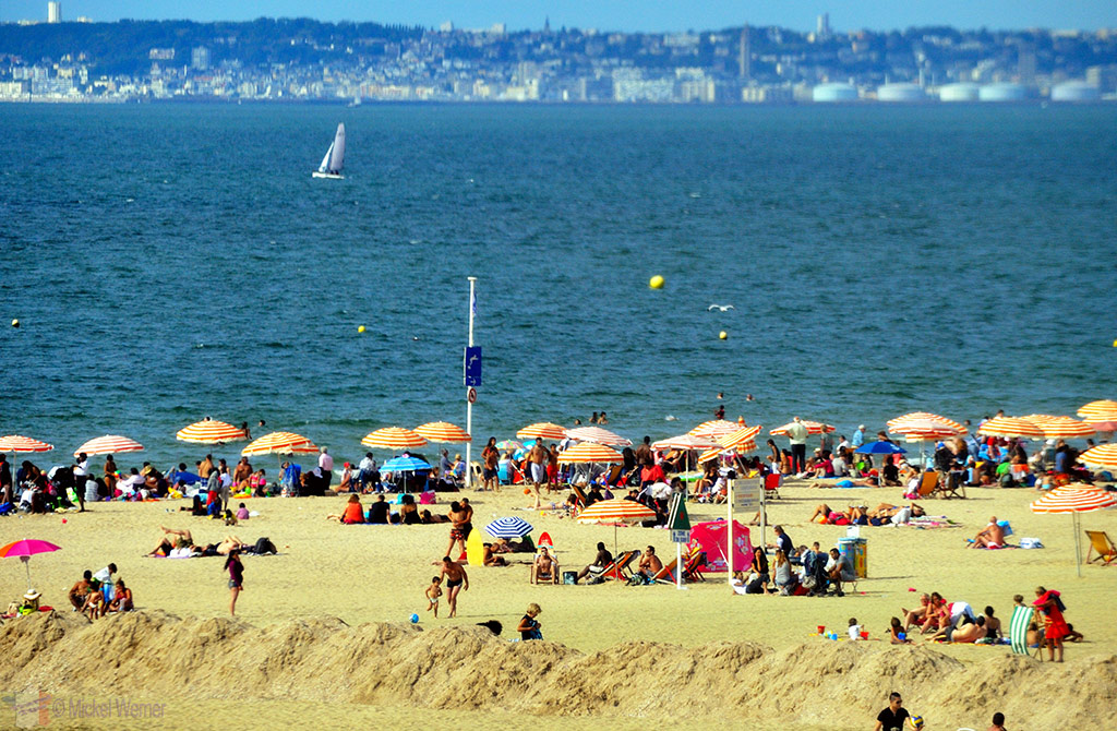 Crowded sandy beach of Trouville-sur-Mer