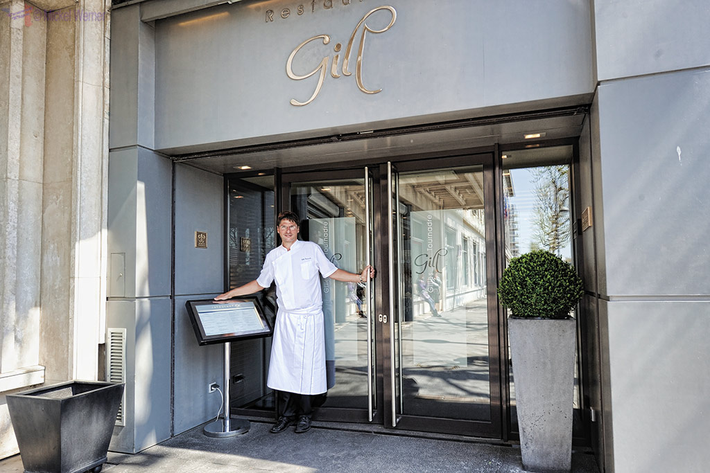 Chef Gill in front of his Restaurant named after him.