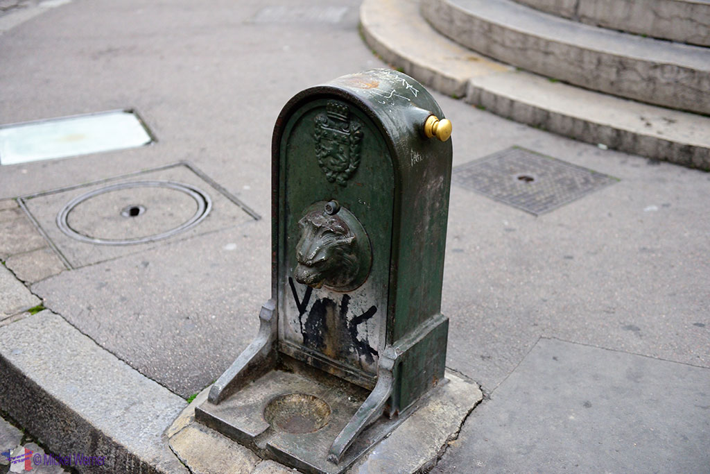 A small fountain next to the bigger one in front of the Cathedrale Saint-Jean-Baptiste de Lyon - Saint John the Baptist Cathedral of Lyon
