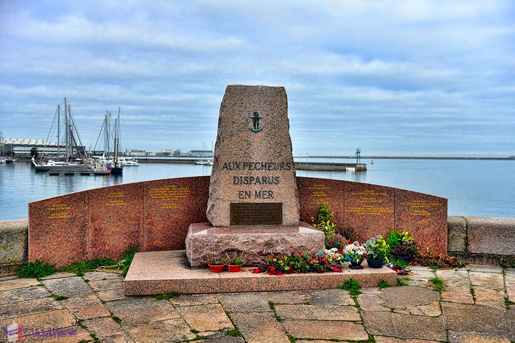 Fishermen monument in front of the Cite de la Mer museum in Cherbourg