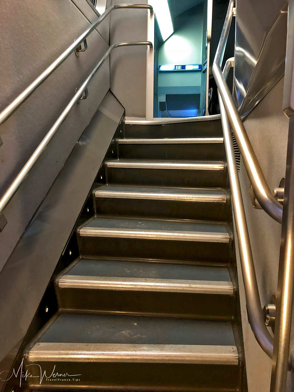 Stairs leading to the upper level of a TGV train