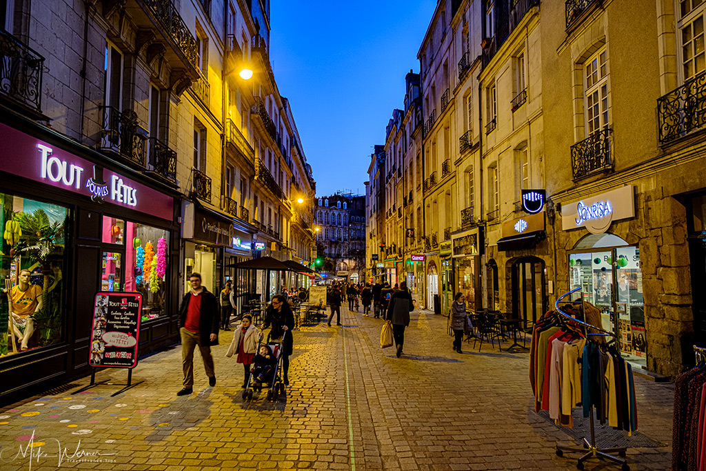 Nightfall in a pedestrian shopping street in Nantes