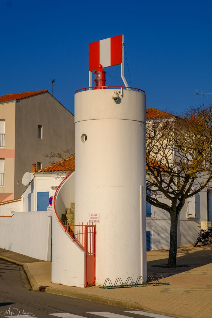 Small lighthouse alongside the harbour waterways at Les Sables-d'Olonne
