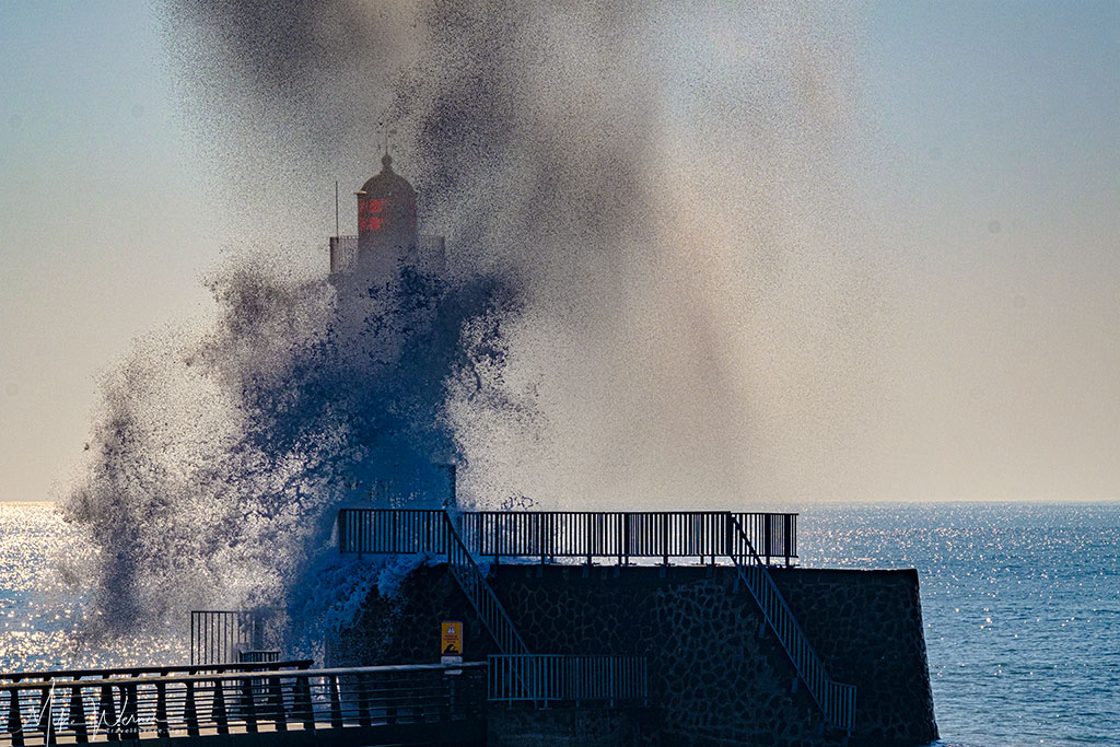 Massive waves hitting the lighthouse at Les-Sables-d'Olonne