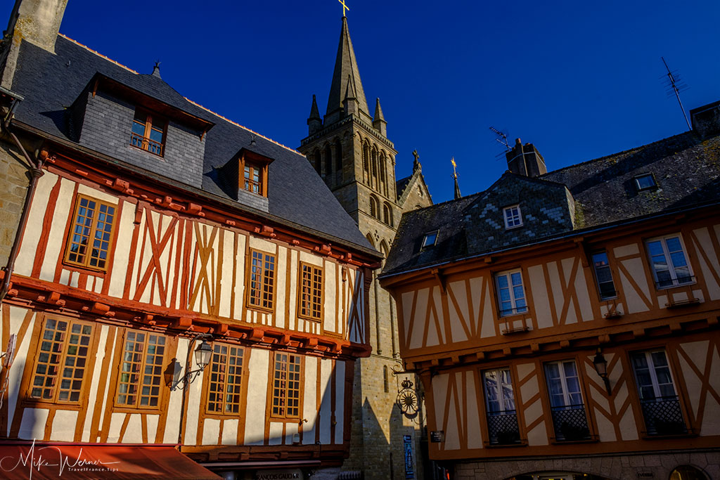 Wooden houses from the 15th century with church in the background in Vannes, Brittany