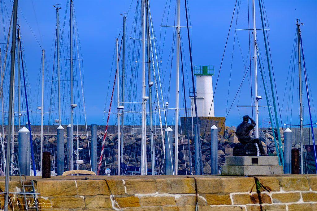 Fisherman statue looking to the sea at Port Haliguen in Quiberon, Brittany