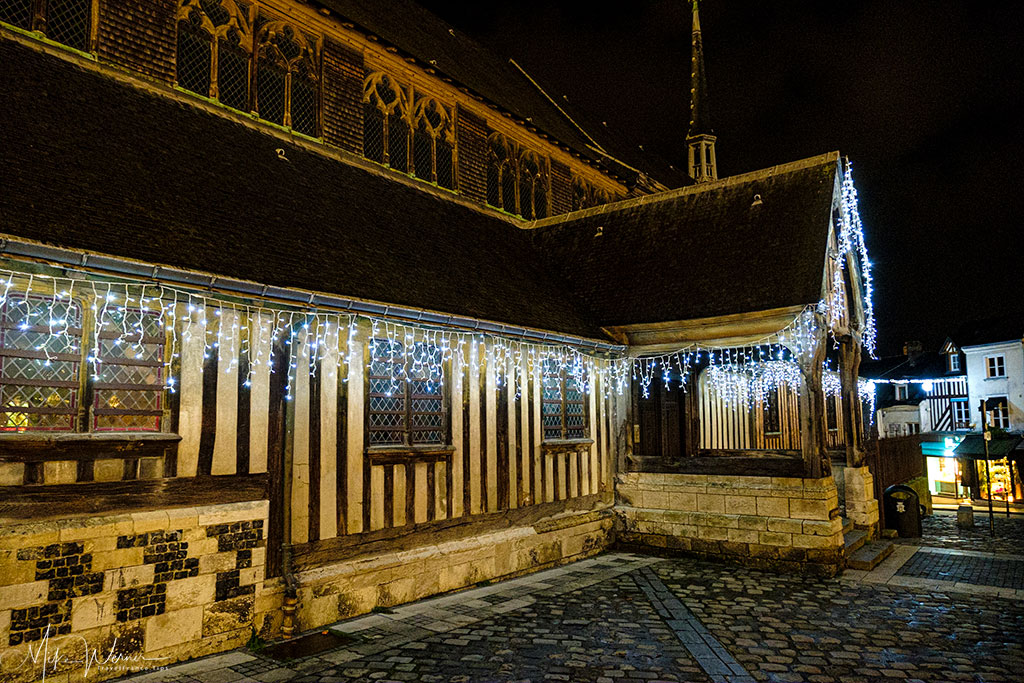 Side entrance of the mostly wooden nave of the Saint-Catherine church in Honfleur, Normandy at night
