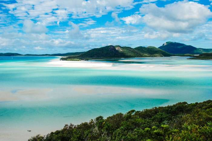 You could travel and work in Australia on a boat cruising the Whitsunday Islands!