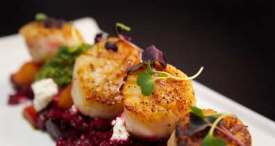 Seared sea scallops from Posana, one of the best places to eat in Asheville