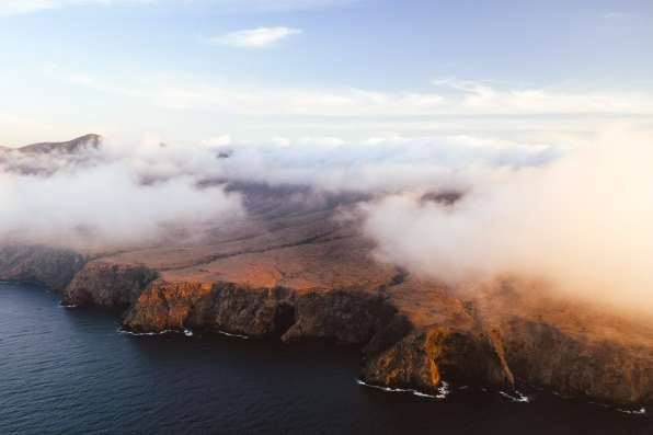 Clouds rolling in over Santa Cruz Island, shot from a helicopter
