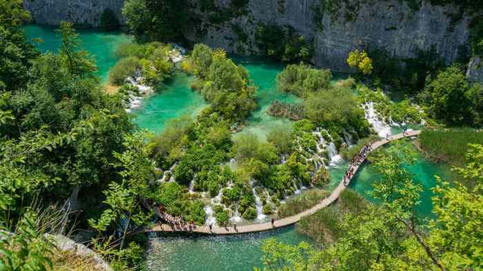 Exploring Plitivice waterfalls during your travels in May.