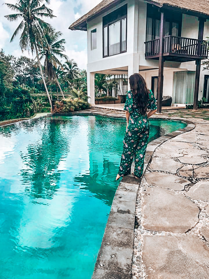 Emily Rose dips a toe in a villa pool in Bali.