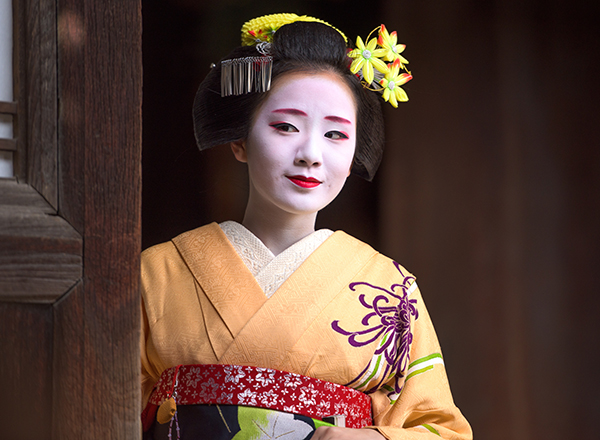 Woman in traditional geisha attire, Kyoto, Japan